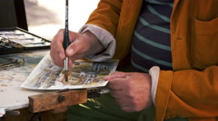 Shot of artist painting using watercolors a scene in Venice. Stock Footage