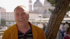 Portrait shot of an artist smiling for the camera in Venice. Stock Footage