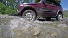 Car Niva crossing the ford on the small river Uskut, Crimea Stock Footage