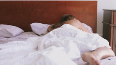 Woman sleeping on bed Stock Footage
