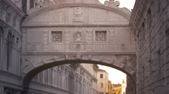 Stock Video Footage of Panning down from the bridge of Sighs to a gondola floating the canal below.