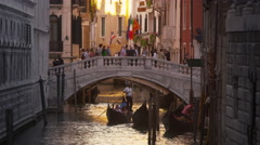 Slow motion shot of people crossing a bridge over a canal in Venice, Italy. Stock Footage