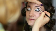 Model making-up for photo session in studio Stock Footage