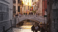 Downward slow motion tilt shot of focusing on a gondolier in Venice, Italy. Stock Footage