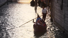 Upward titling slow motion shot of a canal in Venice, Italy. Stock Footage
