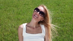 Portrait of a young woman on a green lawn Stock Footage