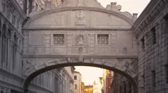 Tilt shot of the Bridge of Sighs and the canal beneath it Stock Footage