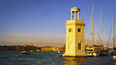Slow motion still shot of a unique white lighthouse in the Venetian bay. Stock Footage
