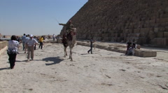 Bedouin Man Riding a Camel Next to the Pyramids of Giza - stock footage