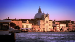 Slow motion, panning shot of the Bauer Palladio Hotel from across the waterway - stock footage