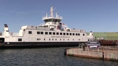 The small ferry ISEFJORD enters the ferry berth in Hundested Harbour Stock Footage