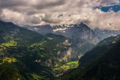 Jungfrau peak and Lauterbrunner, Kleine Scheidegg villages on moutainsides - stock footage