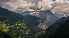 Jungfrau peak and Lauterbrunner, Kleine Sheiddeg villages on moutainsides 4K Stock Footage