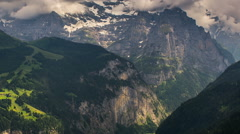 Jungfrau massif rock faces and alpine valley time lapse Stock Footage