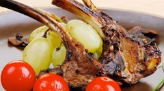 Roasted ribs on wooden table Stock Footage