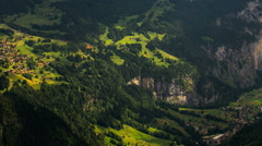 Lauterbrunnen and Kleine Scheidegg villages on mountainsides - stock footage
