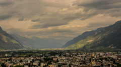 Matigny city Rhone valley rain storm in the distance time lapse Stock Footage