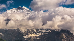 Jungfrau peak and glaciers clouds covering mountain Stock Footage