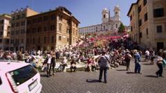 Long shot tilt up to Trinita dei Monti in slow motion Stock Footage