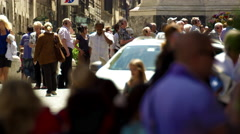Two taxis pass in slow motion between crowded sidewalks in Rome, Italy Stock Footage