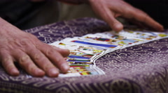 Close-up slow motion footage of hands shuffling tarot cards Stock Footage