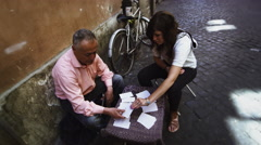 Woman receives her fortune on a Roman street Stock Footage