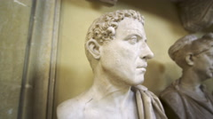 Tracking shot of head and shoulder sculptures inside Vatican Stock Footage
