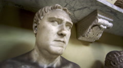 Tracking bust shot influential male sculptures inside Vatican Stock Footage