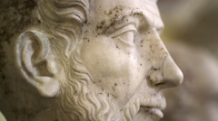 Rack focus footage of roman stone bust sculptures in the Vatican Stock Footage