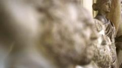 Racking focus shot of roman stone bust sculptures in the Vatican Stock Footage