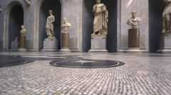 Slow pan of statues, busts, and floor of New Wing Stock Footage
