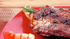 Savory on red plate: grilled meat Stock Footage