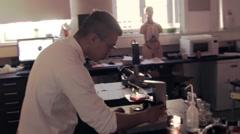 Virus under the microscope in laboratory 2 Stock Footage