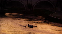 Footage of rowing boat underneath bridge on the Tiber River. Stock Footage