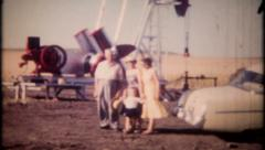 2330 - people inspect the new oil rig on their farm - vintage film home movie Stock Footage
