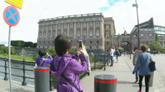 ASsian women fotograph Government buildings in Stockholm Stock Footage