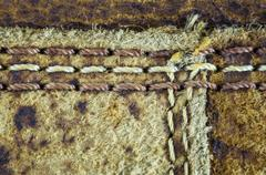 Textured of old leather and seam. - stock photo