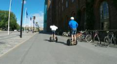 Segways outside city hall in Stockholm Stock Footage