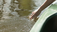 Hand glides over water surface, slow motion HD - stock footage