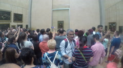 People stand in line to watch the Mona Lisa from close Arkistovideo