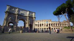 Slow motion footage of the Arch of Constantine and Colosseum Stock Footage