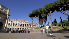 Slow motion pan toward the Arch of Constantine and Colosseum Stock Footage