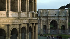 Stock Video Footage of Shot of Arch of Constantine with Colosseum in the foreground.