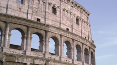Downward tilt from tip of Colosseum to the Arch of Constantine Stock Footage