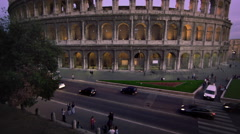 Tilt up to illuminated Colosseum during the evening. Stock Footage
