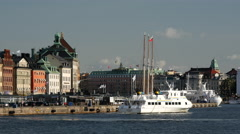 Ferry leaving Gamla stan old town in Stockholm Sweden Stock Footage