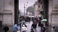 Tourists exiting and entering the Piazza del Popolo Stock Footage