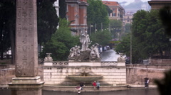 Fontana del Nottuno and nearby obelisk on a rainy day Stock Footage