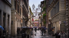 Trinita dei Monti from the street Via Dei Condotti Stock Footage