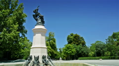 Fountain of the fallen angel. Angel caido. Madrid El Retiro park. Stock Footage